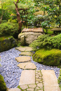 Stone path leads to well and lantern in Portland Japanese Garden