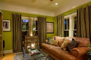eclectic-living-room-colours-lime-green-couch-behr-swiss-coffee-animal-print-antique-luggage-area-rug